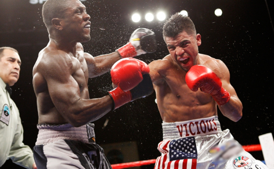 Ortiz landing punch in his first fight against Berto
