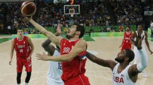 Serbia shoots as Kyrie Irving (USA) of the USA defends.