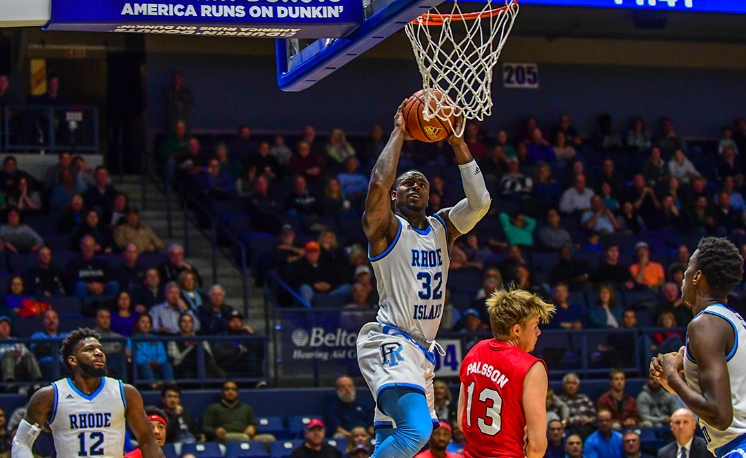 Jared Terrell driving to basket against Marist