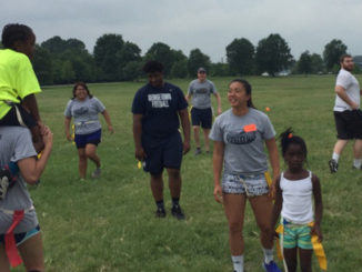 Hoya players volunteering for camp