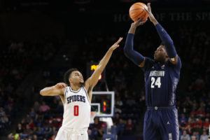 Georgetown Hoyas forward Marcus Derrickson (24) shoots the ball over Richmond Spiders guard Jacob Gilyard (0) during the second half at Robins Center. The Hoyas won 82-76.