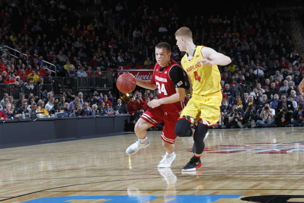 Wisconsin's Davison driving the ball against Maryland's Huerter