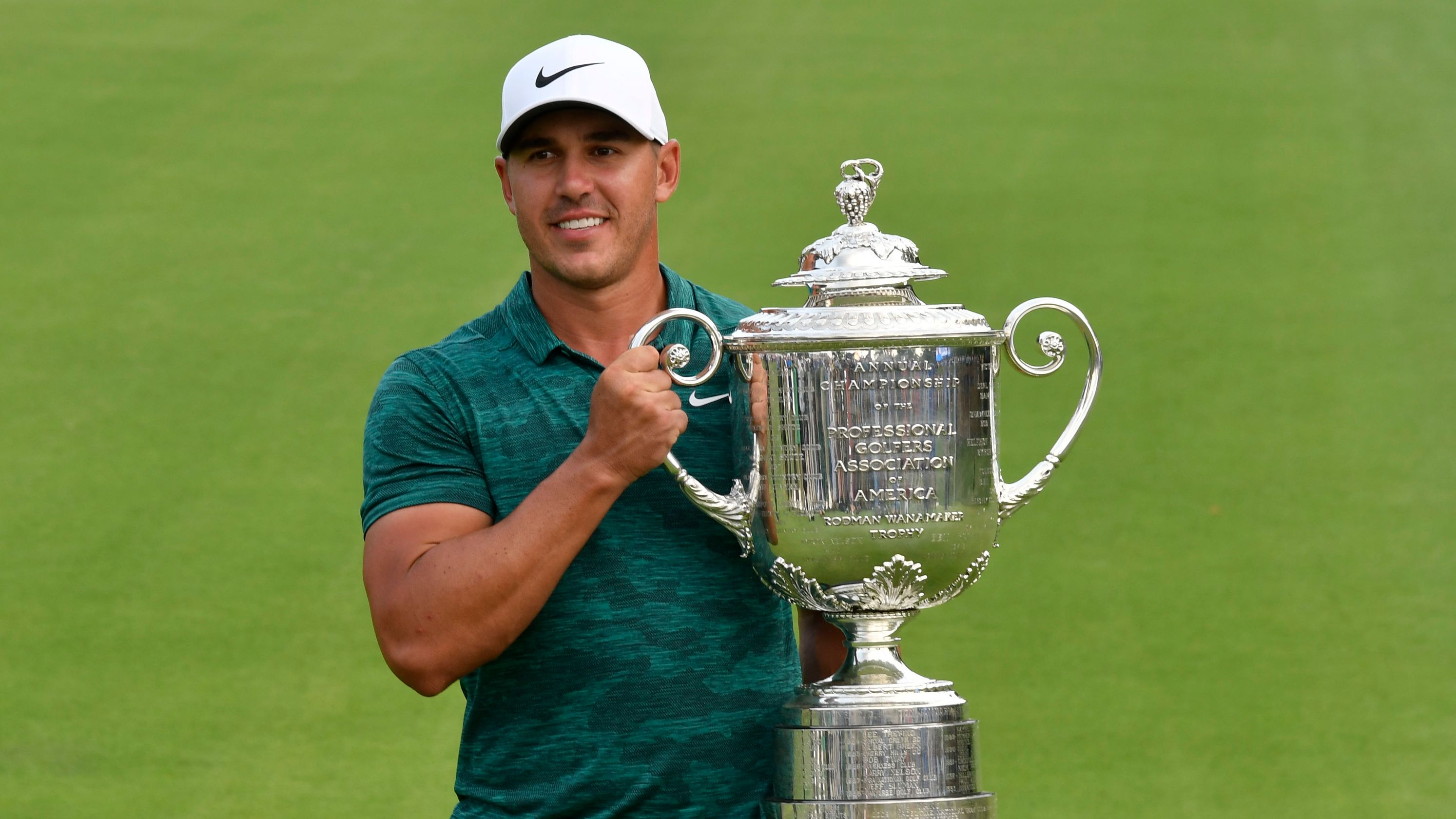 Brooks Koepka with the Wanamaker Trophy