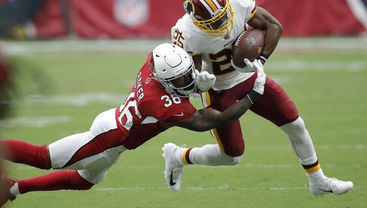 Washington Redskins running back Chris Thompson (25) is hit by Arizona Cardinals defensive back Budda Baker (36) during the first half of an NFL football game, Sunday, Sept. 9, 2018, in Glendale, Ariz. (AP Photo/Ross D. Franklin)