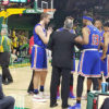 American players and coach during a timeout